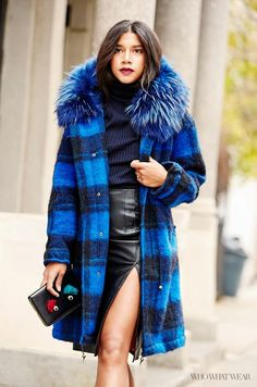 Pair a navy blouse and a black leather skirt with a statement coat and a black clutch.