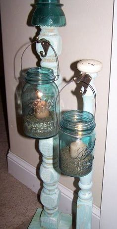 Re posting this great idea From Parga's Junkyard. Mason Jar, wire, table leg & hook is all you need to make these ! These are perfect for my porches!
