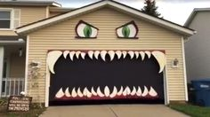 "TODAY People can't stop watching this Halloween 'monster garage' go up and down | Oct. 18, 2016 | http://www.today.com/home/people-can-t-stop-watching-halloween-monster-garage-go-down-t104090 | ""Amanda Destro Pierson in Ohio hand-painted everything on craft foam and used duct tape to hold the teeth in place. She hung the eyes using siding hooks and fishing line."""