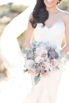 Succulent bouquet with soft pastel purple, pink roses and dusty miller. Perfect for the desert
