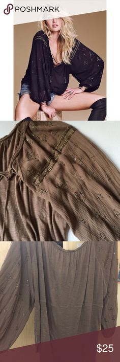"""Free People """"Golden Nugget"""" Peasant Top Beautiful top from Free People. Brown color. Lace up. Flowy sleeves with gorgeous embroidery. Good used condition as pictured- the neckline came frayed but definitely has increased. Cute little bells on the lace up-some color has rubbed off them; not noticeable when wearing. Wide neckline so can be worn off shoulder. Soft fabric. Boho chic :) Free People Tops Blouses"""