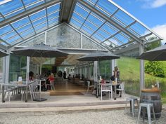 Brick Bay cafe - winery in a glass house across a river