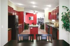 We love the color scheme with Red Cherry cabinets in this modular home! You can choose your own cabinets! Avondale Marquis • 25AMQ28603BH • 1570 sq.ft • 3 Beds • 2 Baths • $81,000 - $94,000 #cherrycabinets #modularhome #modernhousing