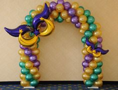 Mardi Gras Balloon Arch With Masks Made From Balloons