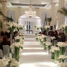 Lots of white calla lillies for aisle decor