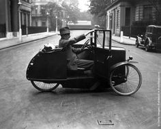 1928: A man cycling a One-Man Car Cycle in a street in the West End of London