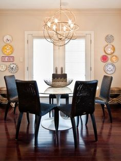 I love the light fixture http://adoreyourplace.com/2012/11/12/lighting-wow-dining-rooms/