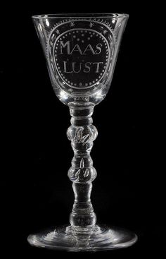 A Dutch engraved light baluster commemorative goblet, mid 18th century, the round funnel bowl inscribed MAAS LUST within a round border, on a baluster stem and a conical foot, 18.5cm high