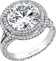 Jeweler Neil Lane got his start at a small counter in a Hollywood store and went on to become the go-to man for bling in Tinseltown: He has created spectacular diamond engagement rings for Jennifer Hudson (above), Portia de Rossi,. Cute Engagement Rings, Celebrity Engagement Rings, Round Diamond Engagement Rings, Diamond Rings, Halo Engagement, Solitaire Diamond, Diamond Flower, Diamond Jewelry, Bling Bling