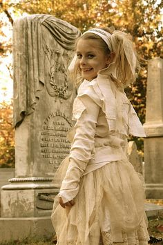 Mummy costumes... also love the pictures at the cemetary