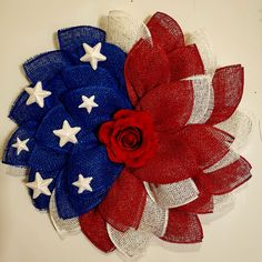 Get your house ready with amazing American decor like this gorgeous DIY Patriotic Flower Wreath by Sue Reid Huggins. Grab this wreath or DIY one yourself by grabbing your own flower wreath frame at Unique in the Creek! Wreath Crafts, Diy Wreath, Decor Crafts, Wreath Ideas, Home Decor, Summer Door Decorations, Patriotic Decorations, Burlap Flower Wreaths, Deco Mesh Wreaths