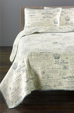 Parisian 'Avalon' Quilt features soft blue French script and motifs on a cream background. via Nordstrom at Home