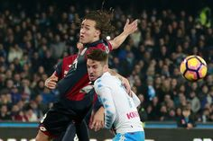 Napoli's Belgian forward Dries Mertens (R) fights for the ball with Genoa's Argentinian defender Santiago Gentiletti  during the Italian Serie A football match SSC Napoli versus Genoa CFC on February 10, 2017, at the San Paolo Stadium in Naples. / AFP / CARLO HERMANN