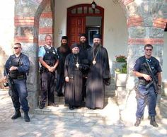 Archimandrite Nektarios Serfes and His Grace, Bishop Teodosije visiting a local monastery, accompanied by protective UN peacekeepers (the two monks in the background are Hierodeacon Jevsevije (l) and hieromonk Andrej (r)