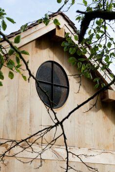 Oak wood house black metal window