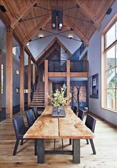 Dining table and chairs-Wooden floorboards, columns and roof unify the rooms framework and contrast well against light grey.