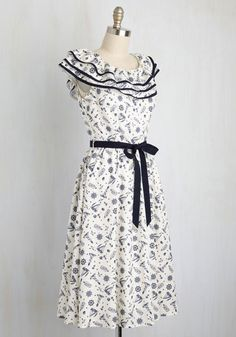 Coming to a wardrobe near you - this nautical midi dress! Printed with lighthouses, seagulls, sailboats, and more, this ivory frock continues its waves of great reviews with a ruffled, tiered neckline, navy trim, and matching sash. Time to show 'em you're the star of the 'shore'!