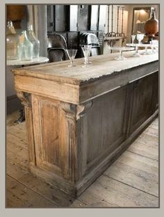 oak shop counter (makes me think that having an old shop counter or display case for a kitchen island might be cool)