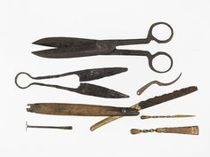 Selection of Tudor and medieval implements used for personal hygiene and dated between 1200s-1500s. Although medieval doctors were uncertain whether bathing was good for you ('in time of pestilence avoid baths'), objects such as these metal toothpicks, tweezers, earscoops, shears, scissors and razor show that medieval and Tudor Londoners cared about personal grooming.