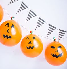 Or, cut out eye, nose, and mouth shapes from black contact paper, then stick them onto balloons for no-rot, no-carve jack-o-lanterns.