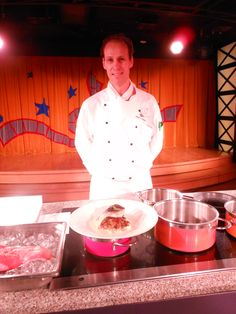 CHEF ALEX from Animator's Palate onboard the DISNEY WONDER.  Do not miss the food demonstrations for the Art of Entertaining.  This picture a Pan Seared Alaskan Salmon with an Apple Butter Sauce and Herbed Potato Pancakes. I really enjoy Salmon and this ranks up there with the best I have ever eaten.  The sweet apple butter sauce added to the Salmon was singing praises in my mouth. Read More on blog.#cruise #Disney #Alaska #Animatorspalate #vacation #Disneywonder @Disney
