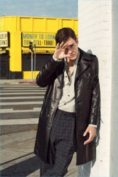 Sporting a leather coat and tailored separates, Josh Beech wears brands Lanvin and Valentino.