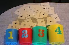 A note name is called out. The students run down and put the right card into the right bucket.
