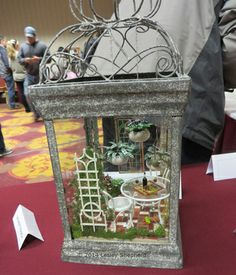 Dollhouse scale patio vignette in a garden lantern exhibited by Barbara Tynon at the Spring 2014 Seattle Dollhouse Show.