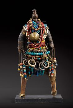 Africa | Dowayo doll from the Dowayo Namji people of North West Cameroon, near the Nigerian border | Wood, textiles, glass beads, cowrie shells, metal | ca. early to mid 1900s | 23,500€ ~ Sold (Sothby's Dec 2008, Paris)