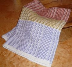 Weave Structures Group of the South Coast Weavers and Spinners Guild studied Ms and Os. This isa lattice treadling on a traditional Ms and Os threading,woven in unmercerized cottons. Other items you may enjoy:Four Shaft CrackleM's & O's crib blanket and pillowDoubleweave Overshot JacketOcean fingersBlack and White wall hanging