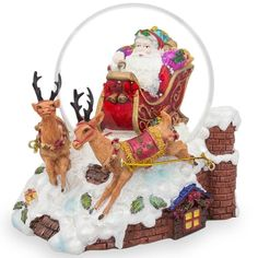 Santa Sleigh and Reindeers Deliver Christmas Gifts Musical Snow GlobeThis charming Christmas Snow Globe features Santa riding his sleigh with two reindeer in front of him. It has a beautiful hand. Santa Snow Globe, Christmas Snow Globes, Christmas Crafts, Christmas Ornaments, Christmas 2019, Glass Ornaments, Vintage Christmas, Christmas Decorations, Kelly Wearstler