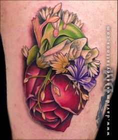 36c083f51c0a8 Tattoo by David Mushaney Colorful anatomical heart tattoo composed of  flowers. Eternal Ink. Rebel