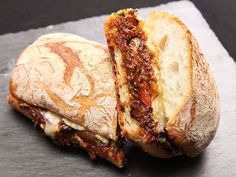 A savory sandwich made with braised oxtail, pickled cherry peppers, and melted Gruyère cheese.