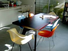 Gus table with fiberglass Eames style chairs