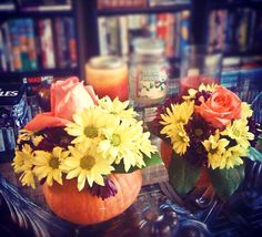 We hosted a party at our house, and I decided that this would be a great opportunity to test out the cost and time effectiveness of my DIY centerpiece idea: flowers in a real pumpkin vase. Here's how I pulled it off...