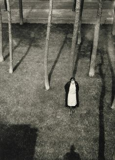 Lucia Moholy in the garden behind the Masters' Houses at the Bauhaus, Dessau. Photo by Laszló Moholy-Nagy, c.1926