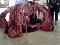 "Haven as Retro-Menstrual Hut by TriRay  TriRay consists of two female artists—sculptor, Patricia ""Trish"" Conley and painter, Raychel Ma aka Remmzita. They use their distinctive ways of seeing and being in the world as jumping off points in their collaborative art-making."