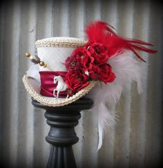 Derby Hat, Mini Top Hat, Alice in Wonderland.... I mean it's ridiculous, but awesome, ha. $45
