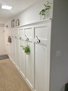 We needed a solution for hanging our coats and this long wall in our entryway was the perfect solution! Diy Upholstery Cleaner, Diy Essential Oil Diffuser, Craftsman Style Doors, Faux Shiplap, Long Walls, Pallet House, Diy Couch, How To Make Curtains, Diy Chalkboard