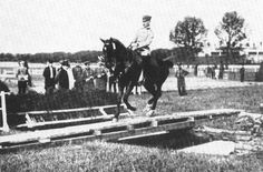 You think equestrian competition is difficult today? Check out this test of straightness: cantering over a narrow plank over water with reins in one hand!