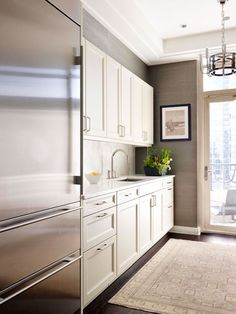 grey, white and stainless steel kitchen  Ritz Carlton Showcase - De Giulio design
