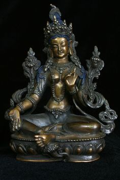 """Green Tara (""""the Saviouress""""), a Buddhist bodhisattva of compassion born from the tears, or a lotus-flower that grew from the tears of Avalokitesvara. Her primary form is Green Tara. As White Tara She is very popular as well, and is said to grant long life. Tara White as the Autumn Moon represents Wisdom, for the moon is the symbol of wisdom in Buddhist Tantra"""
