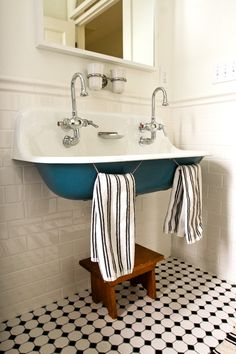 loving this blue sink - black and white tile floors