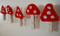 Good idea for displaying Christmas cards - although obviously not with the toadstools! Use clothespins that you & kids have decorated during the year.