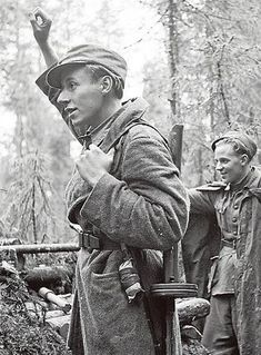 News about cease-fire between Finland and Soviets have reached frontlines and Finnish soldier is waving towards soviets lines. The Soviet Union ended hostilities exactly 24 hours after the Finns. Photo has been taken in Uuksujärvi 4.9.1944