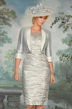90399 (Condici) Ruched silk dress with bolero jacket in Cream & Platinum. The dress has a stripe pattern throughout, a mesh neckline with embroidered detailing to the front and onto the shoulder. The bodice and skirt are ruched which flatters Read More...