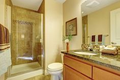 Yellow, orange and ivory keep the bathroom feeling warm all winter. Check out our other color ideas: http://steamshowersinc.com/blog/monthly-pick-the-bathroom-remodel-how-to-choose-the-right-paint/