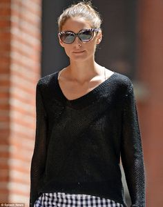 Olivia Palermo s holey sweater reveals skimpy white crop top as she stalks  around the Big Apple d9276a37d6892