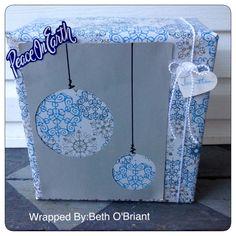 Christmas Baubles Gift Wrap. Simple and Easy, draw rings on the back side of paper, use hole punch to make a hole for the scissor to start the cut.