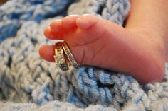 Baby with ring on foot by Jamie Reed  #photography #baby #rings